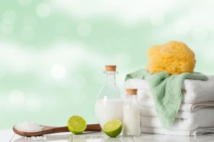 spa linens with towels and sponge