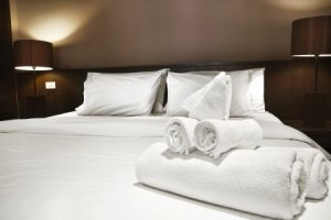 neatly made hotel bedding